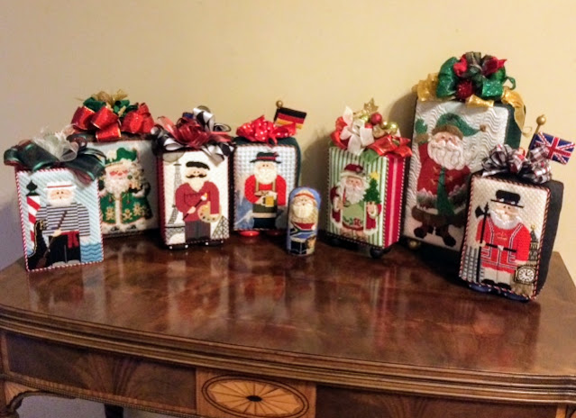 Collection of Santa standups stitched by Gretchen